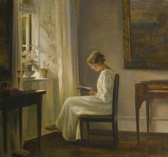 Carl Holsøe, 1863 - 1935 Interior with a woman reading