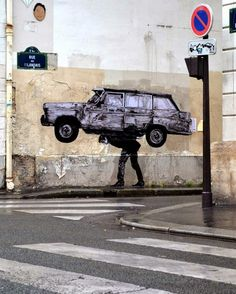 Man carring car