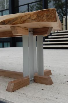"""Detail of coffee table leg. Coffee table is constructed of Chicago area walnut, norwegian maple aluminum, polished stainless steel bolts & washers. Table is designed for a fictional space described in Haruki Murakami's novel """"Norwegian Wood"""". Table is meant to be used in the mountain asylum cottage where Toru, Naoko & Reiku sit, talk, drink and play music."""