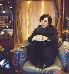 """""""I feel like this is Sherlock's natural waiting pose he looks like a kid waiting to be picked up"""" (Tumblr)"""