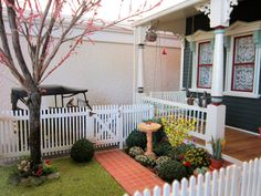 Perfectly manicured yard by the talented Kathleen Holmes!  (Miniature redbud tree?  Awesome!)
