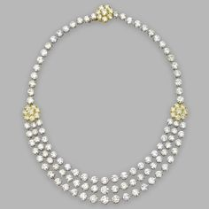 YELLOW AND NEAR COLORLESS DIAMOND NECKLACE. Round diamonds of yellow and near colorless hue weighing a total of approximately 81.70 carats, mounted in 18 karat gold and platinum