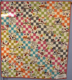 Nine-Patch with Alternate Blocks by Diana McClun and Laura Nownes, quilted by kathy August, p. 31 of Quilts! Quilts!! Quilts!!! 3rd edition