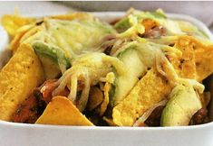 Avocado And Bean Nachos by Taste. Teach your kids healthy eating with these easy-to-assemble vegetarian nachos. Mexican Appetizers, Cold Appetizers, Mexican Food Recipes, Nacho Recipes, Mexican Cooking, Mexican Dishes, Lunch Recipes, Vegetarian Nachos, Vegetarian Appetizers