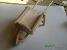 """step by step tutorial on how to make a wheelbarrow (translated - i believe """"two pieces of these chinese food"""" means a pair of chopsticks - love auto translators, lol)  *********************************************   el-manitas #miniature #dollhouse #fairy #garden #wheelbarrow hh"""