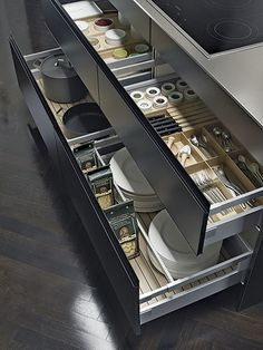 The matt black cabinet exterior highlighted a tidy system of decorative and versatile new interior drawer accessories in light oak and white glazed ...
