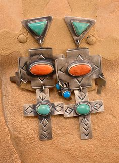 Silver cross dangle earrings set with Turquoise and Coral cabochons by The Mummy's Bundle