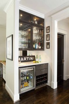 Contemporary living room bar nook is filled with gray glass front ...