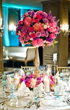 Fabulous Colorful Centerpiece using a Tall #FlowerTower, a Card Holder, and Short & Tall Candles. Visit us for your centerpiece supplies http://www.WedCrafts.com