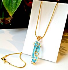 """Natural aquamarine raw crystal necklace Wired with gold plated wire 20"""" gold plated snake chain Aquamarine evokes the purity of crystalline waters, and the exhilaration and relaxation of the sea. It is calming, soothing, and cleansing, and inspires truth, trust and letting go. In ancient lore, Aquamarine was believed to be the treasure of mermaids, and was used by sailors as a talisman of good luck, fearlessness and protection. It was also considered a stone of eternal youth and happiness…"""