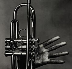 Irving Penn. Miles Davis hand and trumpet, New York, July 1, 1986