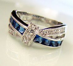 Stunning 2 Carat Lab Blue Sapphire Love Knot Ring Size. Starting at $5 on Tophatter.com!