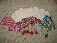Mittens inspired from our natives: the samii-people/lapp people. They are to be knitted in bright white, bright red,bright blue, bright green and bright yellow. The main colour is always bright white. and second colour is often red and blue. Fingerless Mittens, Knit Mittens, Knitted Gloves, Norwegian Knitting, Mittens Pattern, Wrist Warmers, Yarn Shop, Knitting Designs, Comfort Zone