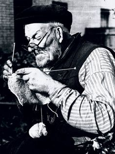 Elderly man knitting as part of the war effort during WWII, 31 October 1939. Did anyone ever say, Thank You Sir...