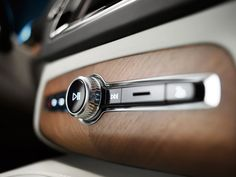 """Though the XC90 comes equipped with a 9"""" touchscreen panel display, Volvo designers respected that even in the era of touch-swipe a dial and button are still the superior interface for control while driving."""