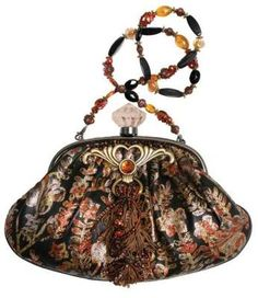 """Mary Frances Baroque Bag.    A coveted purse from the highly collected designer: An autumn palette of burnt orange, midnight and moonlight are rendered to velvet and festooned with brass findings, stones and plumage in the designerÕs distinctive style. Faux crystal clasp. Limited edition. 12 x 7 x 2""""."""
