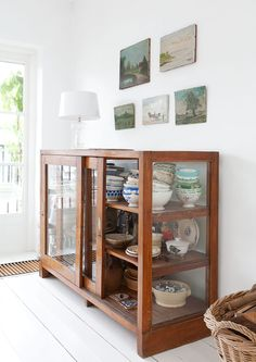 Love this vintage wood and glass display cabinet!