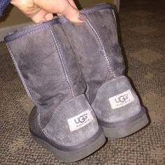 Grey Short Uggs Short Grey Uggs. Size 7. Shows signs of wear. No tears or stains but obvious used condition. Soles still in good condition as well as fur inside. UGG Shoes Ankle Boots & Booties