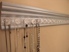 Lots of jewelry storage on this wall hung necklace holder silver w 15 decorative small acrylic knobs with silver metallic finish 20 inches Necklace Storage, Necklace Holder, Jewelry Holder, Jewellery Storage, Jewelry Organization, Jewellery Display, Earring Holders, Jewelry Box, Jewelry Cabinet
