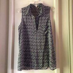 Nordstrom sleeveless black&white blouse NWOT this sleeveless chiffon like flowy sleeveless blouse has a small pocket on the front. Cute print and placket front Pleione Tops Blouses