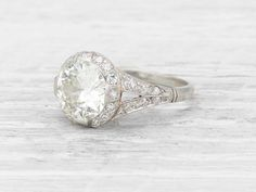 Art Deco engagement ring set with an old European-cut diamond weighing approximately 2.77 carats. 28 single-cut diamonds weighing approximately 0.40 carats total add additional detail with surround and shoulders. Set in platinum. French hallmark. Circa 1920. This Art Deco engagement ring is not short on sparkle! It's all about the diamond. Learn more about old European-cut diamonds. Diamond and gold mining has caused devastation in areas such as Africa, wreaking havoc on delicate ecosyste...