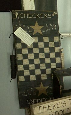 Primitive wooden checker board on Etsy, $30.00