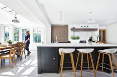 A four-bedroom equestrian property in Surrey. The old lean-to was replaced with a large hardwood orangery. The brief was to design a spacious kitchen with large communal island and a separate boot room. Kitchen Units, New Kitchen, Kitchen Dining, Kitchen Ideas, Grey Kitchens, Cool Kitchens, Larder Cupboard, Compact Kitchen, Plan Design