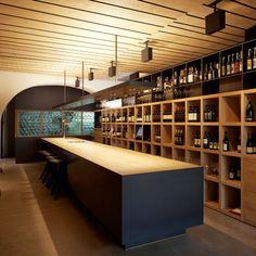 bar counter made of brushed wood, wooden wine rack, bar furnishing
