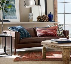 Who says that a leather sofa is masculine? When paired with rustic woods and global inspired textiles, you create a look that is chic and distinctive.