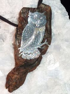 Silver engraving horned owl