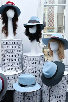 Maison Michel: The ultrachic hats of Maison Michel were done in blue-and-burgundy combos, often with a silver metal band. [Photo by Xavier Granet]