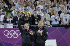 May-Treanor and Walsh Jennings receive their gold medals during the women's beach volleyball medal ceremony.