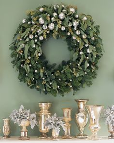 Create this glittering decoration by trimming a noble fir wreath with silvery ornaments and sprigs of seeded eucalyptus. (We used approximately 100 ornaments of varying sizes.) For instructions on how to paint new glass ornaments so that they'll look like antique mercury glass, get our how-to for Antiquing Glass Ornaments.