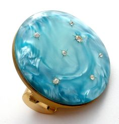 """Vintage Vanity Items - This is a beautiful blue round mirror lipstick holder compact, carved moonglow lucite with inset clear rhinestones. It has never been used, mirror is 2"""" in diameter, excellent c"""