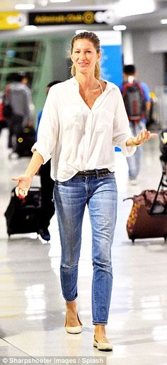 Natural: The supermodel turned the airport arrivals into a catwalk as she looked fabulous ...