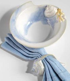 "Perfect bowls for serving up seafood pasta, or a nice ciopinno! 2.25"" deep x 6.75"" diameter, every hand made bowl is hand painted with sea blues, delicate raised clam shells and a coral accent!"