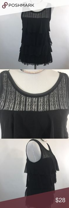 WHBM Black layered lace tank size medium WHBM Black tank size medium. The body of the tank is black knit. There are layers of lace and the knit over that. The front and back yoke are black lace. This is a beautiful and versatile top. Please check pictures for details and measurements. Thanks for visiting my closet! White House Black Market Tops Tank Tops