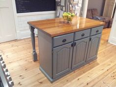 DIY-created this by using the bottom half of the kitchen dining dresser and turning it into a kitchen island. Used second hand timber legs from the salvage yard.