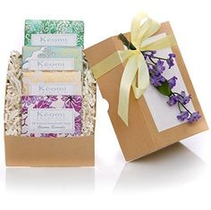 ORGANIC HANDMADE SOAP GIFT SET  Scented w100 Pure Essential Oils  4 Full Size Bars  Packaged in an Elegant Embossed Gift Box w Satin Ribbon  Floral Embellishment  Each Bar Individually Wrapped in Handmade Artisan Paper PAMPER HER w LUXURY WHILE LIFTING HER SPIRITS ** Check out the image by visiting the link.