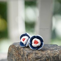polymer clay flowers by ketlin white, red, blue