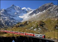 Bernina Express,Switzerland. Amazing! If you a photographer I recommend to ask for seating in the last wagon. So you can take great pictures of the Viaduct
