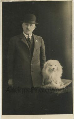 Man in hat with funny white dog antique rppc photo