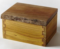 Mulberry and cherry box with double dovetail joints and natural edge lid.