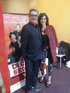 "Maria Grazia Cucinotta, the brand ambassador of MariaGrazia Severi fashion house, and Neri Parenti at the presentation of their new movie ""Di che segno sei"". Maria Grazia Cucinotta  wearing a Maria Grazia Severi outfit from Fall/Winter collection."