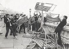 Photograph taken by the Brighton Herald, of a gang of Mods on the roof terrace of Brighton Aquarium. 1964. There was a famous clash between Mods and Rockers on Brighton Beach in 1964. (rockers wore leather jackets and rode motorbikes - mods dressed smartly and rode scooters)