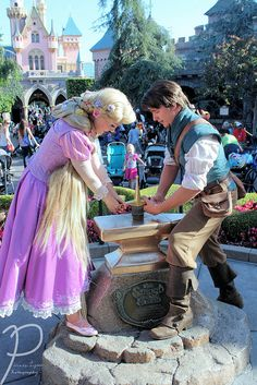 Flynn and Rapunzel Pulling the Sword from the Stone- i only saw rapunzel pulling when i was there and i wished i took a picture