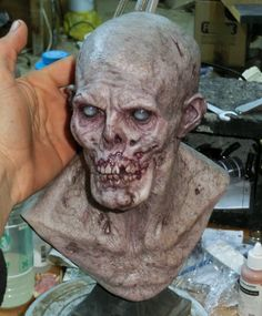 Yet another zombie bust. They are good for anatomy practice This one is cast in PU resin. the eyes are part of the cast just painted to look like that.