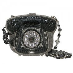 Call Me  Be prepared to be called day and night, this beautiful handbag in the shape of a telephone speaks the language of love, amore, chiamami, te amo! The strap is removable and may be worn as a necklace. ~Mary Frances
