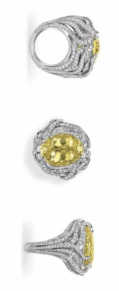 A YELLOW BERYL AND DIAMOND RING, MOUNTED BY TAFFIN  Set with an oval-cut yellow beryl, within a baguette-cut diamond surround, to the pierced circular-cut diamond scrolling gallery and half-hoop, mounted in platinum Signed Mounting by Taffin