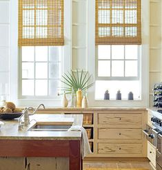 Natural materials bring the beach indoors in this coastal kitchen. Myhomeideas.com